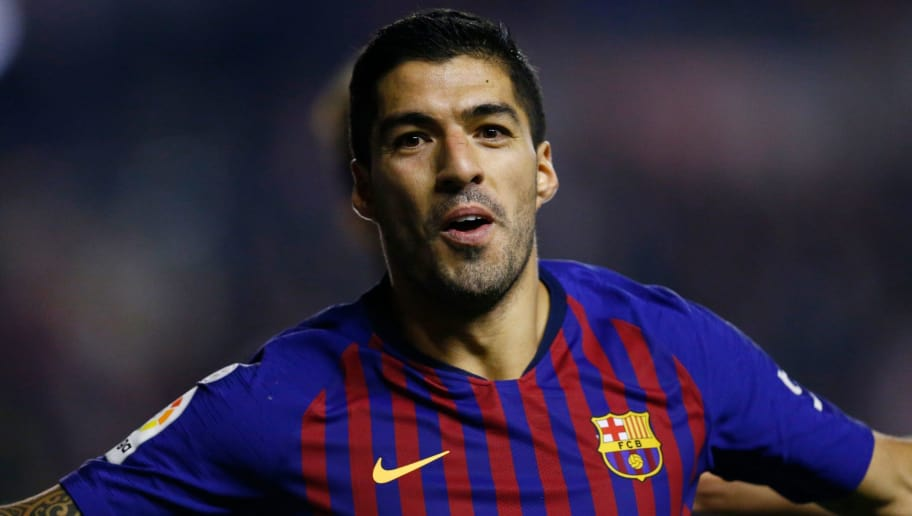 Barcelona's Uruguayan forward Luis Suarez celebrates after scoring a goal during the Spanish league football match between Rayo Vallecano de Madrid and FC Barcelona at the Vallecas stadium in Madrid on November 3, 2018. (Photo by BENJAMIN CREMEL / AFP)        (Photo credit should read BENJAMIN CREMEL/AFP/Getty Images)