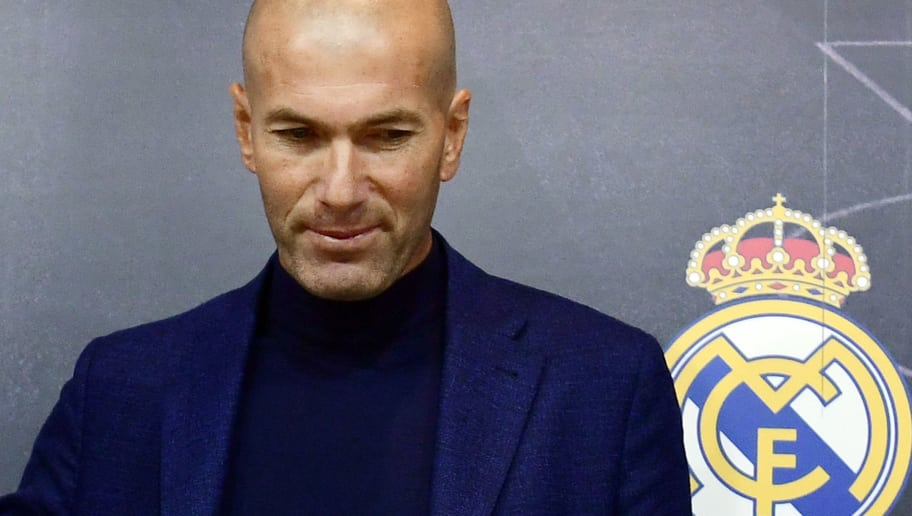 Real Madrid's French coach Zinedine Zidane (R) stands after a press conference to announce his resignation in Madrid on May 31, 2018. - Real Madrid coach Zinedine Zidane said today he was leaving the Spanish giants, just days after winning the Champions League for the third year in a row. (Photo by PIERRE-PHILIPPE MARCOU / AFP)        (Photo credit should read PIERRE-PHILIPPE MARCOU/AFP/Getty Images)