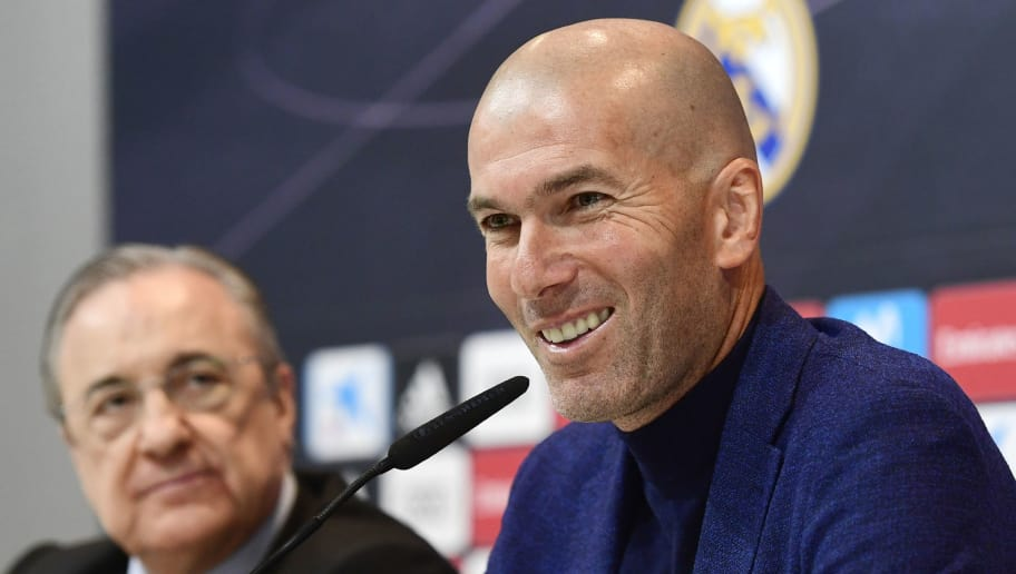 Real Madrid's French coach Zinedine Zidane (R) smiles beside president Florentino Perez during a press conference to announce his resignation in Madrid on May 31, 2018. - Real Madrid coach Zinedine Zidane said today he was leaving the Spanish giants in a surprise move announced just days after winning the Champions League for the third year in a row. (Photo by PIERRE-PHILIPPE MARCOU / AFP)        (Photo credit should read PIERRE-PHILIPPE MARCOU/AFP/Getty Images)