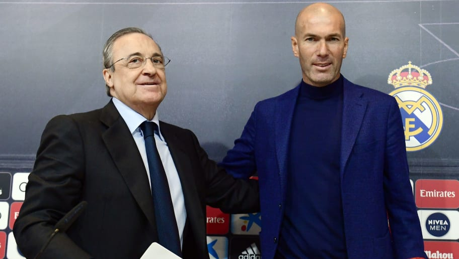 Real Madrid's French coach Zinedine Zidane (R) poses with president Florentino Perez during a press conference to announce his resignation in Madrid on May 31, 2018. - Real Madrid coach Zinedine Zidane said today he was leaving the Spanish giants in a surprise move announced just days after winning the Champions League for the third year in a row. (Photo by PIERRE-PHILIPPE MARCOU / AFP)        (Photo credit should read PIERRE-PHILIPPE MARCOU/AFP/Getty Images)