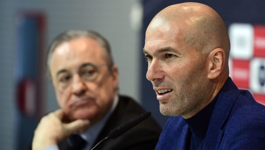 Real Madrid's French coach Zinedine Zidane (R) sits beside president Florentino Perez, during a press conference to announce his resignation in Madrid on May 31, 2018. - Real Madrid coach Zinedine Zidane said today he was leaving the Spanish giants, just days after winning the Champions League for the third year in a row. (Photo by PIERRE-PHILIPPE MARCOU / AFP)        (Photo credit should read PIERRE-PHILIPPE MARCOU/AFP/Getty Images)