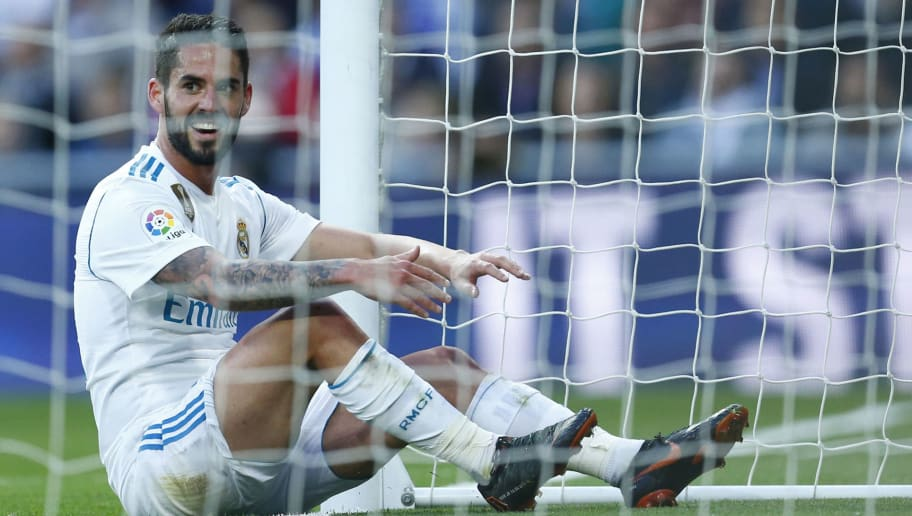 Real Madrid's Spanish midfielder Isco sit in the goal during the Spanish league football match between Real Madrid and Celta Vigo at the Santiago Bernabeu Stadium in Madrid on May 12, 2018. (Photo by Benjamin CREMEL / AFP)        (Photo credit should read BENJAMIN CREMEL/AFP/Getty Images)