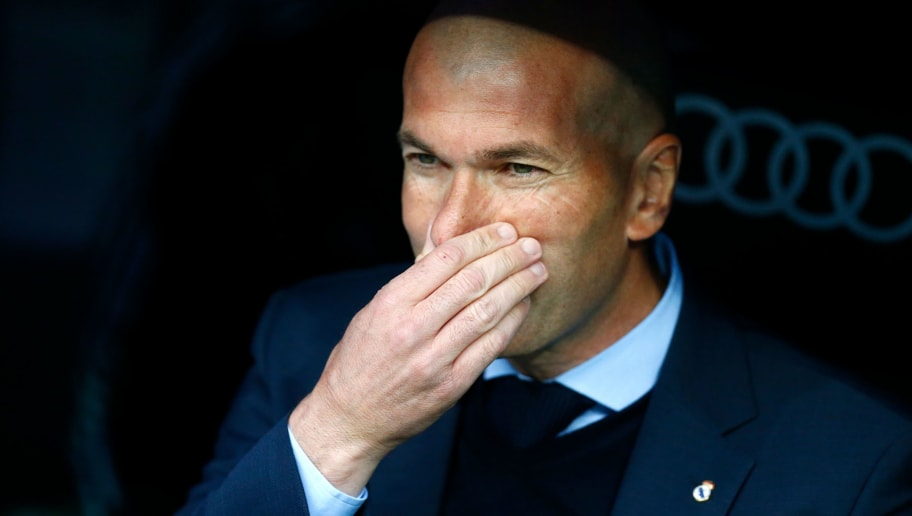 Real Madrid's French coach Zinedine Zidane looks on before the Spanish league football match between Real Madrid and Celta Vigo at the Santiago Bernabeu Stadium in Madrid on May 12, 2018. (Photo by Benjamin CREMEL / AFP)        (Photo credit should read BENJAMIN CREMEL/AFP/Getty Images)