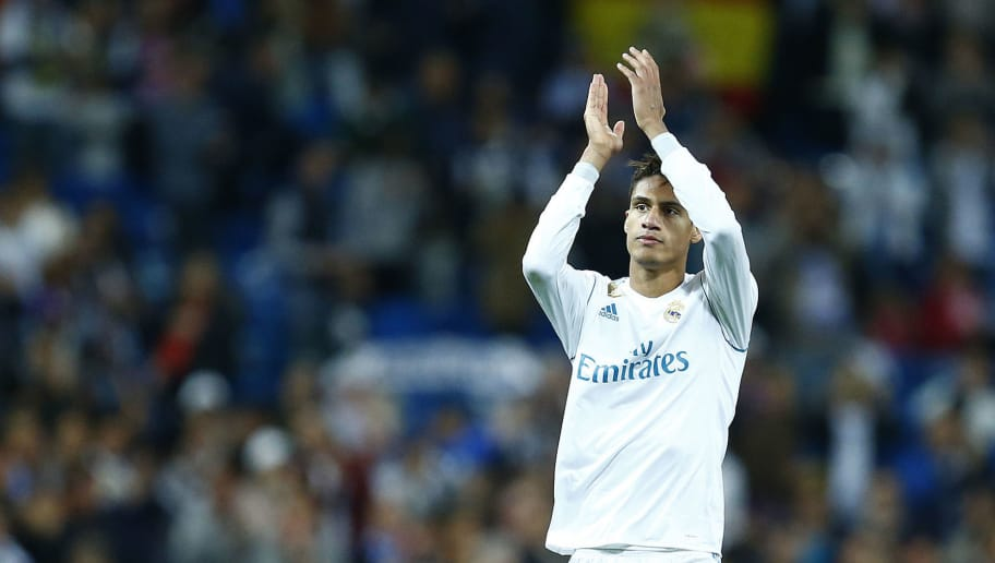 Real Madrid's French defender Raphael Varane applauds during the Spanish league football match between Real Madrid and Celta Vigo at the Santiago Bernabeu Stadium in Madrid on May 12, 2018. (Photo by Benjamin CREMEL / AFP)        (Photo credit should read BENJAMIN CREMEL/AFP/Getty Images)