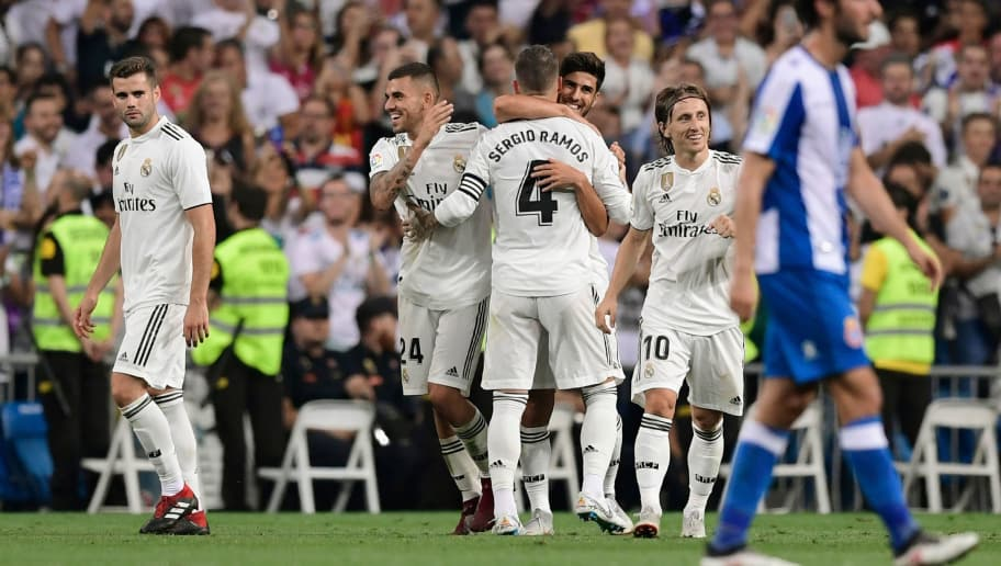 cabb0aa72 Real Madrid s Spanish midfielder Marco Asensio (C) celebrates with teammtes  after scoring during the