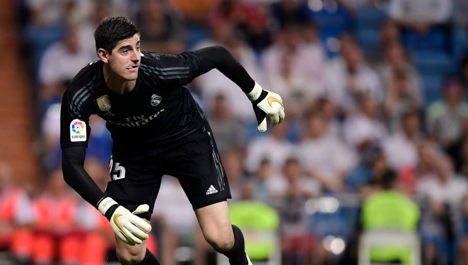 Real Madrid's Belgian goalkeeper Thibaut Courtois gestures during the Spanish league football match between Real Madrid CF and RCD Espanyol at the Santiago Bernabeu stadium in Madrid on September 22, 2018. (Photo by JAVIER SORIANO / AFP)        (Photo credit should read JAVIER SORIANO/AFP/Getty Images)