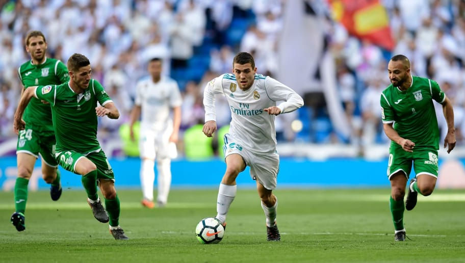 Real Madrid's Croatian midfielder Mateo Kovacic (C) advances with the ball past Leganes' Spanish midfielder Ruben Perez (L) and Leganes' Moroccan forward Nabil El Zhar during the Spanish League football match between Real Madrid and Leganes at the Santiago Bernabeu Stadium in Madrid on April 28, 2018. (Photo by JAVIER SORIANO / AFP)        (Photo credit should read JAVIER SORIANO/AFP/Getty Images)