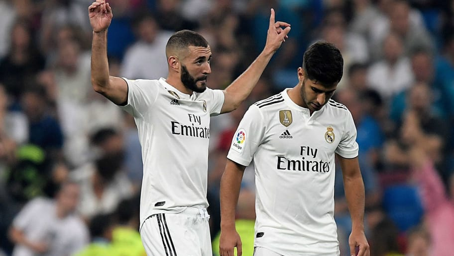 Real Madrid's French forward Karim Benzema (L) celebrates with Real Madrid's Spanish midfielder Marco Asensio after scoring a goal during the Spanish league football match between Real Madrid CF and Club Deportivo Leganes SAD at the Santiago Bernabeu stadium in Madrid on September 1, 2018. (Photo by GABRIEL BOUYS / AFP)        (Photo credit should read GABRIEL BOUYS/AFP/Getty Images)