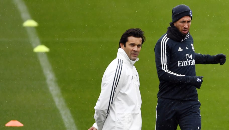 Temporary coach of Real Madrid CF, Argentinian former player Santiago Solari (L) and Real Madrid's Spanish defender Sergio Ramos attend a training session at the Ciudad Real Madrid training facilities in Madrid's suburb of Valdebebas, on October 30, 2018. - Santiago Solari has been put in temporary charge of Real Madrid after Julen Lopetegui was sacked on October 29, 2018. Solari was the coach of Madrid's B team, Castilla, and is now expected to take Madrid for their Copa del Rey game against Melilla tomorrow. (Photo by GABRIEL BOUYS / AFP)        (Photo credit should read GABRIEL BOUYS/AFP/Getty Images)