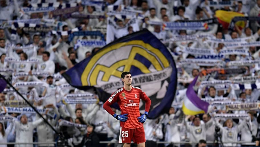 Real Madrid's Belgian goalkeeper Thibaut Courtois reacts during the Spanish league football match between Real Madrid and Valencia at the Santiago Bernabeu stadium in Madrid on December 1, 2018. (Photo by OSCAR DEL POZO / AFP)        (Photo credit should read OSCAR DEL POZO/AFP/Getty Images)