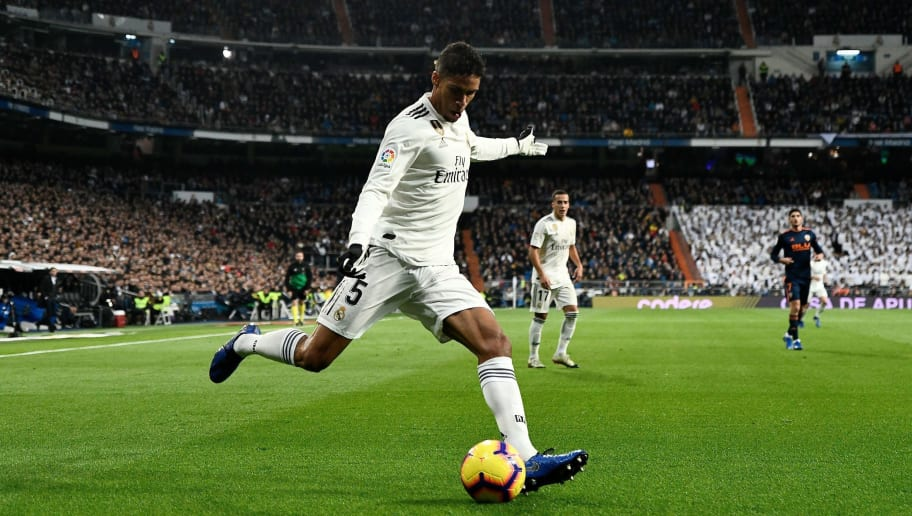 Real Madrid's French defender Raphael Varane kicks the ball during the Spanish league football match between Real Madrid and Valencia at the Santiago Bernabeu stadium in Madrid on December 1, 2018. (Photo by OSCAR DEL POZO / AFP)        (Photo credit should read OSCAR DEL POZO/AFP/Getty Images)