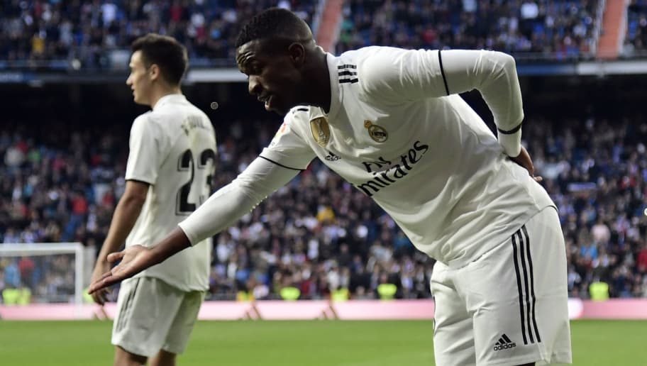 Real Madrid's Brazilian forward Vinicius Junior celebrates Valladolid's own goal during the Spanish league football match between Real Madrid CF and Real Valladolid FC at the Santiago Bernabeu stadium in Madrid on November 3, 2018. (Photo by JAVIER SORIANO / AFP)        (Photo credit should read JAVIER SORIANO/AFP/Getty Images)