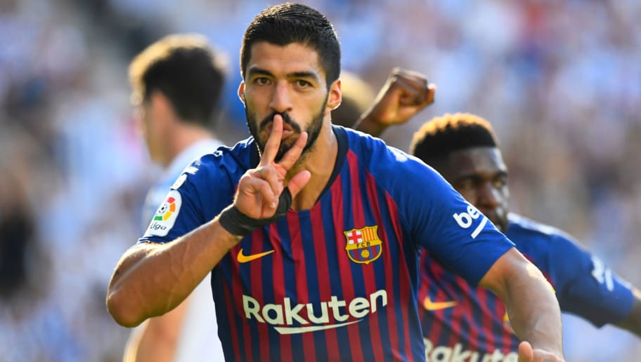 Barcelona's Uruguayan forward Luis Suarez celebrates after scoring a goal during the Spanish league football match between Real Sociedad and FC Barcelona at the Anoeta stadium in San Sebastian on September 15, 2018. (Photo by GABRIEL BOUYS / AFP)        (Photo credit should read GABRIEL BOUYS/AFP/Getty Images)