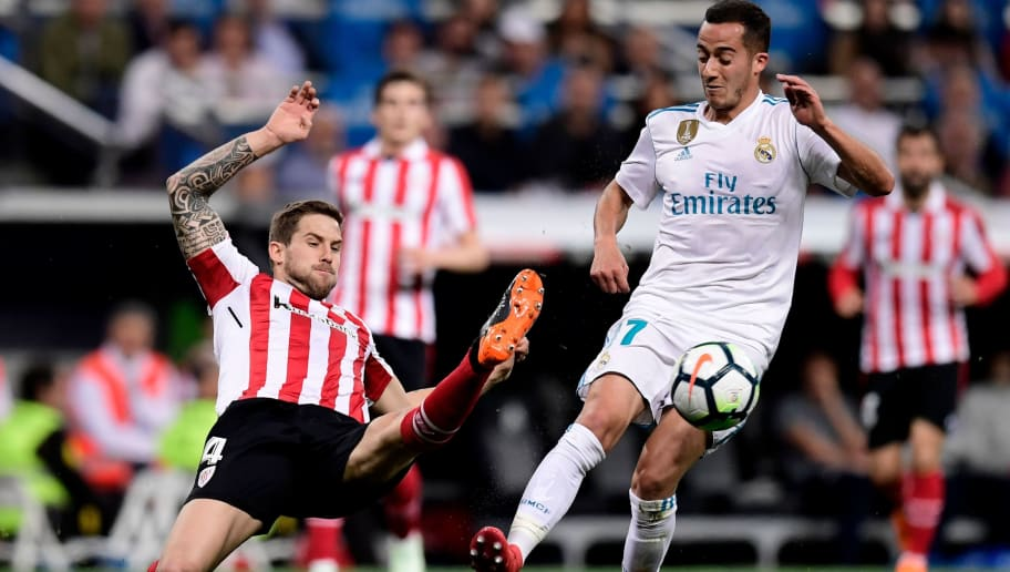 Real Madrid's Spanish midfielder Lucas Vazquez (R) vies with Athletic Bilbao's Spanish defender Inigo Martinez (L) during the Spanish league football match Real Madrid CF against Athletic Club Bilbao at the Santiago Bernabeu stadium in Madrid on April 18, 2018. / AFP PHOTO / JAVIER SORIANO        (Photo credit should read JAVIER SORIANO/AFP/Getty Images)