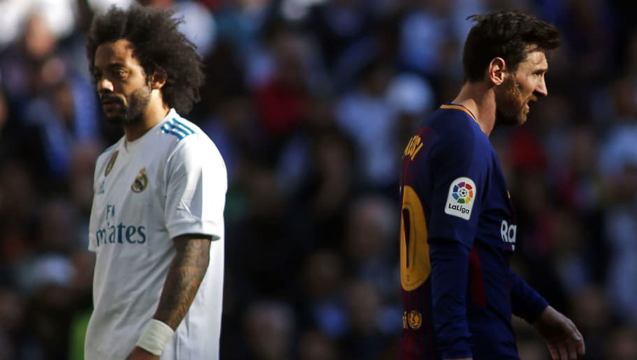 Real Madrid's Brazilian defender Marcelo (L) and Barcelona's Argentinian forward Lionel Messi (R) react during the Spanish League 'Clasico' football match Real Madrid CF vs FC Barcelona at the Santiago Bernabeu stadium in Madrid on December 23, 2017.  / AFP PHOTO / OSCAR DEL POZO        (Photo credit should read OSCAR DEL POZO/AFP/Getty Images)