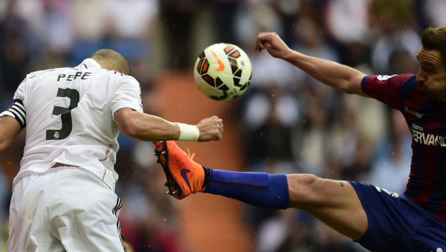 Real Madrid's Portuguese defender Pepe (L) vies with Eibar's midfielder Borja during the Spanish league football match Real Madrid CF vs SD Eibar at the Santiago Bernabeu stadium in Madrid on April 11, 2015.   AFP PHOTO/ JAVIER SORIANO        (Photo credit should read JAVIER SORIANO/AFP/Getty Images)