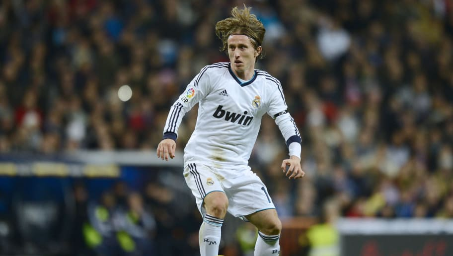 Real Madrid's Croatian midfielder Luka Modric controls the ball during the Spanish league football match Real Madrid CF vs RCD Espanyol at the Santiago Bernabeu stadium in Madrid on December 16, 2012.   AFP PHOTO / PIERRE-PHILIPPE MARCOU        (Photo credit should read PIERRE-PHILIPPE MARCOU/AFP/Getty Images)