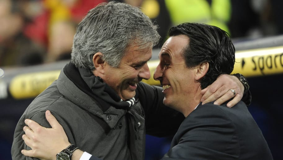 Real Madrid's Portuguese coach Jose Mourinho (L) embraces Sevilla's coach Unai Emery before the Spanish league football match Real Madrid CF vs Sevilla FC at the Santiago Bernabeu stadium in Madrid on February 9, 2013.      AFP PHOTO/ DOMINIQUE FAGET        (Photo credit should read DOMINIQUE FAGET/AFP/Getty Images)