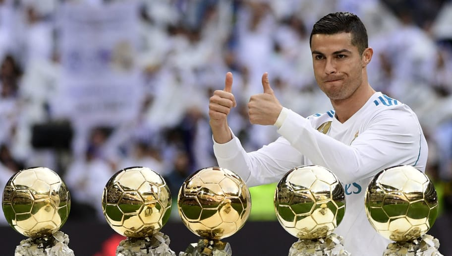 Real Madrid's Portuguese forward Cristiano Ronaldo poses with his five Ballon d'Or trophies ahead of the Spanish league football match between Real Madrid and Sevilla at the Santiago Bernabeu Stadium in Madrid on December 9, 2017. / AFP PHOTO / PIERRE-PHILIPPE MARCOU        (Photo credit should read PIERRE-PHILIPPE MARCOU/AFP/Getty Images)