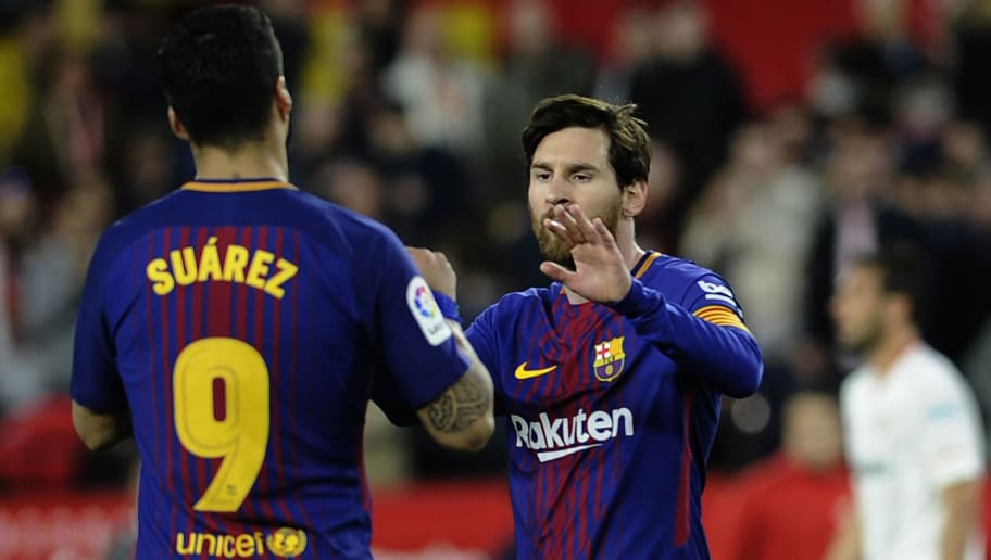 Barcelona's Argentinian forward Lionel Messi (R) celebrates a goal with Barcelona's Uruguayan forward Luis Suarez during the Spanish League football match between Sevilla FC and FC Barcelona at the Ramon Sanchez Pizjuan stadium on March 31, 2018. / AFP PHOTO / Cristina Quicler        (Photo credit should read CRISTINA QUICLER/AFP/Getty Images)