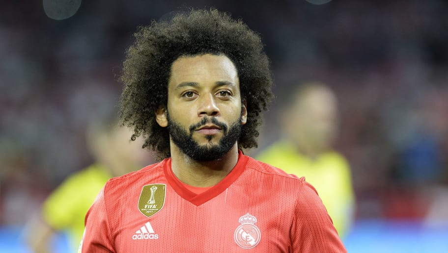 Real Madrid's Brazilian defender Marcelo (C) looks on before the Spanish league football match Sevilla FC against Real Madrid CF at the Ramon Sanchez Pizjuan stadium in Seville on September 26, 2018. (Photo by CRISTINA QUICLER / AFP)        (Photo credit should read CRISTINA QUICLER/AFP/Getty Images)