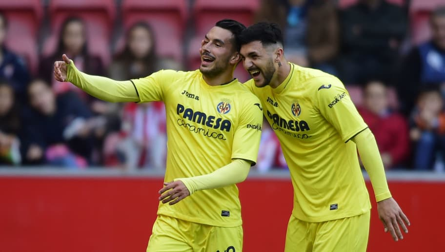 Villarreal's Italian forward Nicola Sansone (L) celebrates with teammate Italian forward Roberto Soriano after scoring a goal during the Spanish league football match Real Sporting de Gijon vs Villarreal CF at El Molinon stadium in Gijon on December 17, 2016. / AFP / MIGUEL RIOPA        (Photo credit should read MIGUEL RIOPA/AFP/Getty Images)