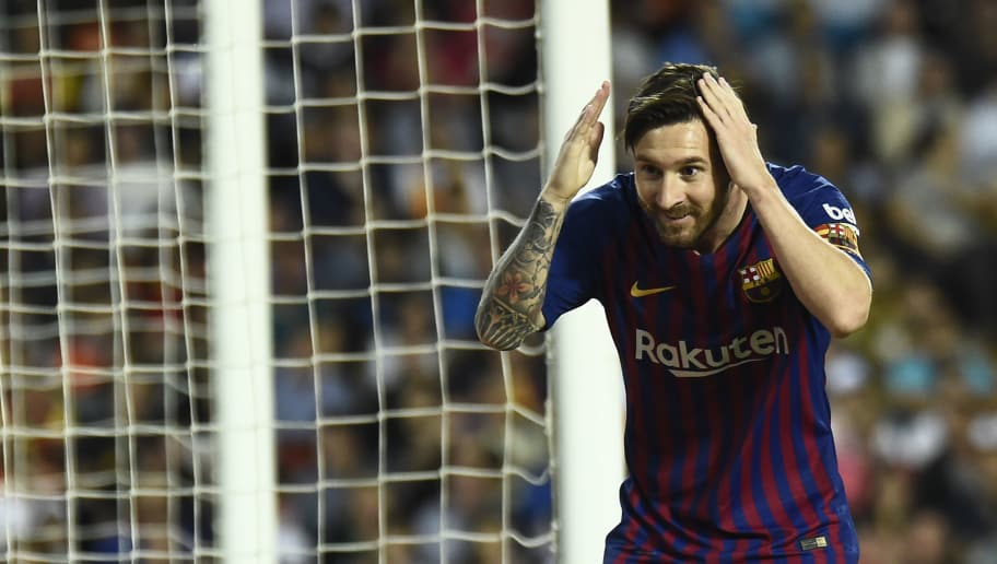 Barcelona's Argentinian forward Lionel Messi celebrates scoring a goal during the Spanish league football match between Valencia CF and FC Barcelona at the Mestalla stadium in Valencia on October 7, 2018. (Photo by JOSE JORDAN / AFP)        (Photo credit should read JOSE JORDAN/AFP/Getty Images)