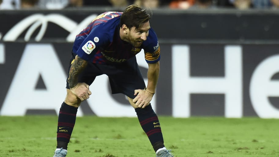 Barcelona's Argentinian forward Lionel Messi bends over during the Spanish league football match between Valencia CF and FC Barcelona at the Mestalla stadium in Valencia on October 7, 2018. (Photo by JOSE JORDAN / AFP)        (Photo credit should read JOSE JORDAN/AFP/Getty Images)