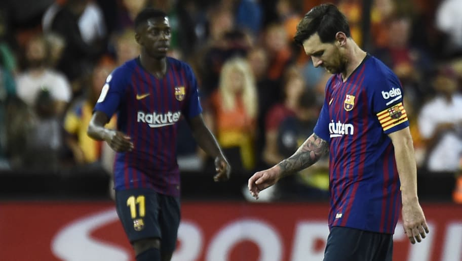 Barcelona's Argentinian forward Lionel Messi (R) looks downwards beside Barcelona's French forward Ousmane Dembele during the Spanish league football match between Valencia CF and FC Barcelona at the Mestalla stadium in Valencia on October 7, 2018. (Photo by JOSE JORDAN / AFP)        (Photo credit should read JOSE JORDAN/AFP/Getty Images)
