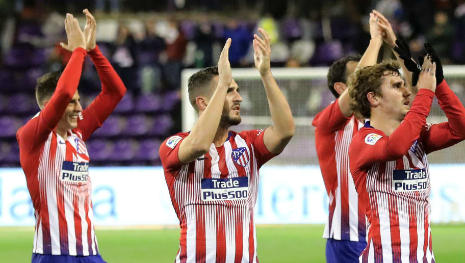 (L-R) Atletico Madrid's Colombian defender Santiago Arias, Atletico Madrid's Spanish midfielder Koke and Atletico Madrid's French forward Antoine Griezmann acknowledge fans at the end of the Spanish League football match between Real Valladolid and Atletico Madrid at the Jose Zorrilla stadium in Valladolid on December 15, 2018. (Photo by CESAR MANSO / AFP)        (Photo credit should read CESAR MANSO/AFP/Getty Images)