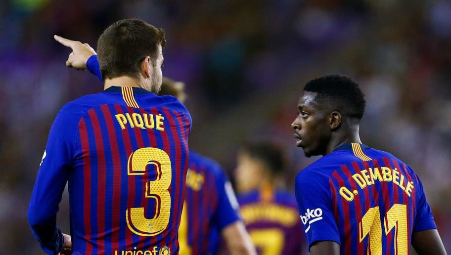 Barcelona's Spanish defender Gerard Pique (L) talks to Barcelona's French forward Ousmane Dembele during the Spanish league football match between Real Valladolid and FC Barcelona at the Jose Zorrilla Stadium in Valladolid on August 25, 2018. (Photo by Benjamin CREMEL / AFP)        (Photo credit should read BENJAMIN CREMEL/AFP/Getty Images)