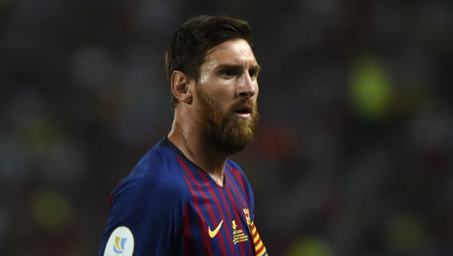 Barcelona's Argentinian forward Lionel Messi looks on during the Spanish Super Cup final between Sevilla and FC Barcelona at Ibn Batouta stadium in the Moroccan city of Tangiers on August 12, 2018. (Photo by FADEL SENNA / AFP)        (Photo credit should read FADEL SENNA/AFP/Getty Images)