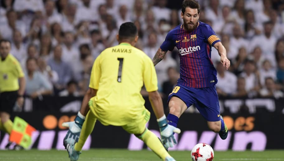 Barcelona's Argentinian forward Lionel Messi (R) vies with Real Madrid's Costa Rican goalkeeper Keylor Navas during the second leg of the Spanish Supercup football match Real Madrid vs FC Barcelona at the Santiago Bernabeu stadium in Madrid, on August 16, 2017. / AFP PHOTO / JAVIER SORIANO        (Photo credit should read JAVIER SORIANO/AFP/Getty Images)