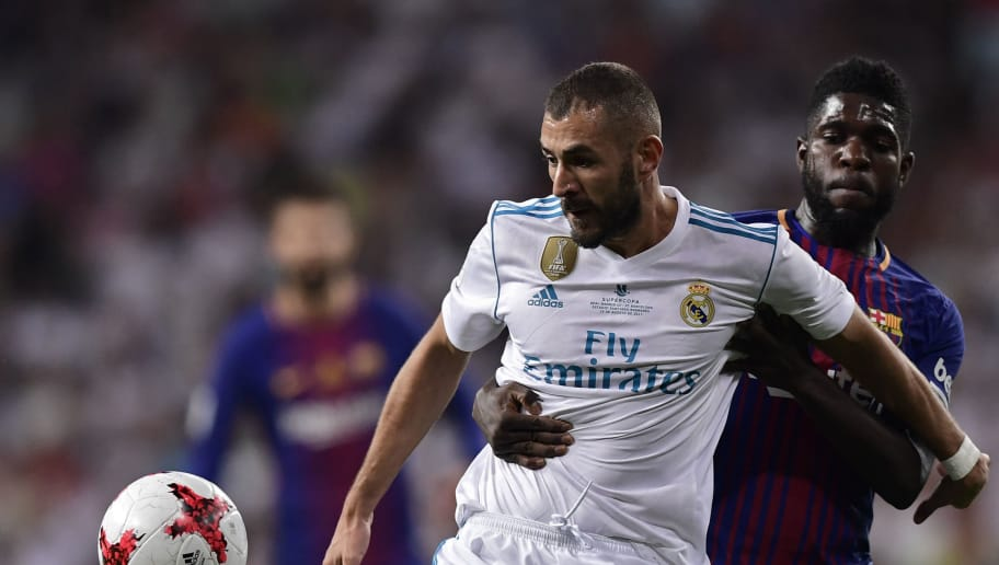 Real Madrid's French forward Karim Benzema (L) vies with Barcelona's French defender Samuel Umtiti during the second leg of the Spanish Supercup football match Real Madrid vs FC Barcelona at the Santiago Bernabeu stadium in Madrid, on August 16, 2017. / AFP PHOTO / JAVIER SORIANO        (Photo credit should read JAVIER SORIANO/AFP/Getty Images)