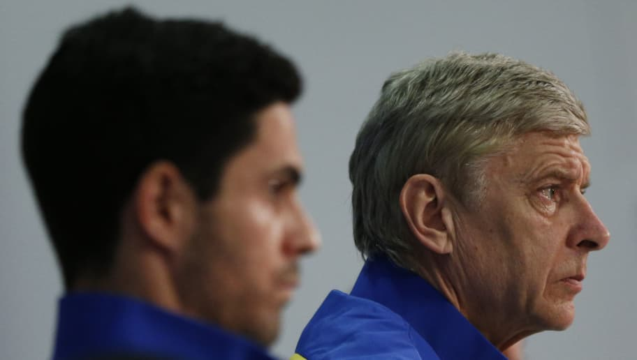FC Arsenal's French head coach Arsene Wenger (R) and Arsenal's Spanish midfielder Mikel Arteta (L) attend a press conference on the eve of the UEFA Champions League last 16 second leg football match between Bayern Munich and FC Arsenal in Munich, southern Germany, on March 10, 2014. AFP PHOTO / PHILIPP GUELLAND        (Photo credit should read PHILIPP GUELLAND/AFP/Getty Images)