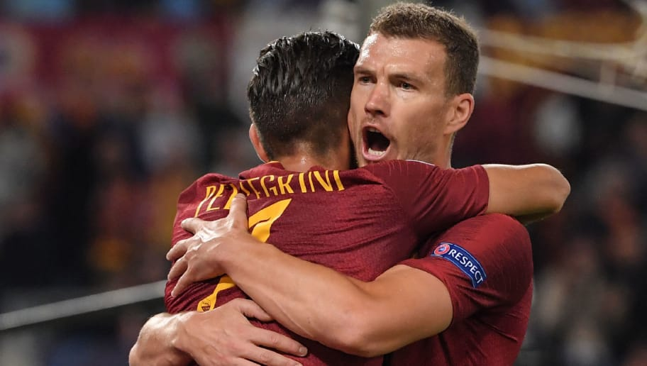 AS Roma Bosnian forward Edin Dzeko celebrates after opening the scoring during the UEFA Champions League group G stage football match AS Roma vs CSKA Moscow on October 23, 2018 at the Olympic stadium in Rome. (Photo by Tiziana FABI / AFP)        (Photo credit should read TIZIANA FABI/AFP/Getty Images)