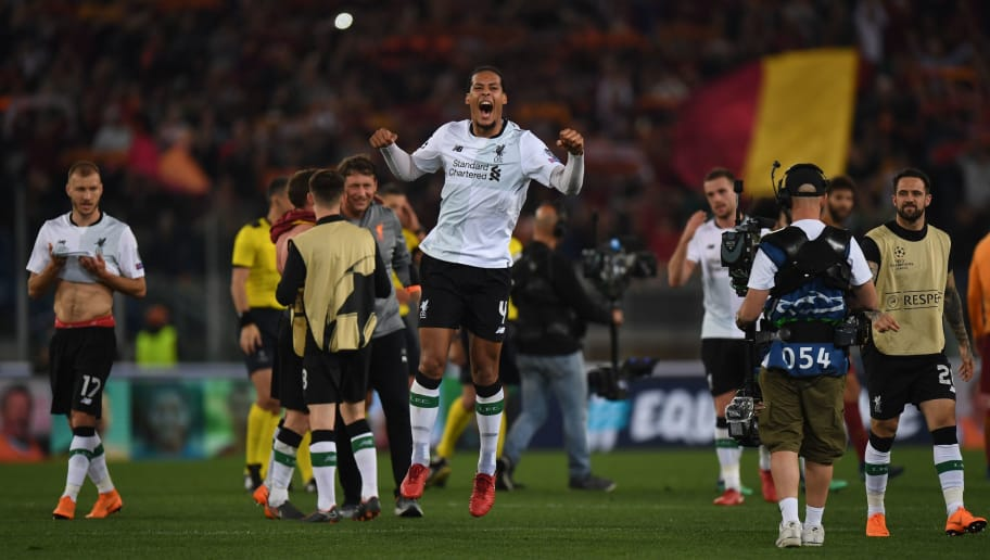 Liverpool's Dutch defender Virgil van Dijk (C) celebrates following the UEFA Champions League semi-final second leg football match between AS Roma and Liverpool at the Olympic Stadium in Rome on May 2, 2018. (Photo by Paul ELLIS / AFP)        (Photo credit should read PAUL ELLIS/AFP/Getty Images)