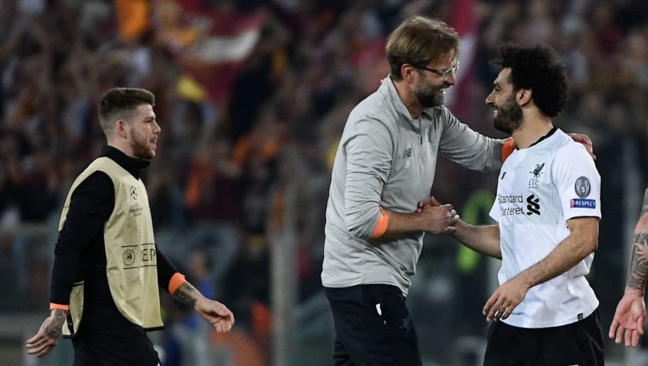 Liverpool's German manager Jurgen Klopp (C-L) celebrates with Liverpool's Egyptian midfielder Mohamed Salah at the end of the UEFA Champions League semi-final second leg football match between AS Roma and Liverpool at the Olympic Stadium in Rome on May 2, 2018. (Photo by Filippo MONTEFORTE / AFP)        (Photo credit should read FILIPPO MONTEFORTE/AFP/Getty Images)