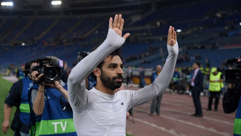 Liverpool's Egyptian midfielder Mohamed Salah applauds the fans following the UEFA Champions League semi-final second leg football match between AS Roma and Liverpool at the Olympic Stadium in Rome on May 2, 2018. (Photo by PAUL ELLIS / AFP)        (Photo credit should read PAUL ELLIS/AFP/Getty Images)