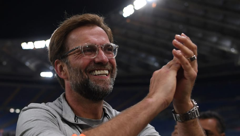 Liverpool's German manager Jurgen Klopp applauds the fans following the UEFA Champions League semi-final second leg football match between AS Roma and Liverpool at the Olympic Stadium in Rome on May 2, 2018. (Photo by Paul ELLIS / AFP)        (Photo credit should read PAUL ELLIS/AFP/Getty Images)
