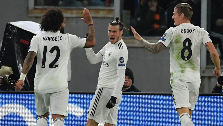 Real Madrid's Welsh forward Gareth Bale (C) celebrates with Real Madrid's German midfielder Toni Kroos (R) and Real Madrid's Brazilian defender Marcelo after opening the scoring during the UEFA Champions League group G football match AS Rome vs Real Madrid on November 27, 2018 at the Olympic stadium in Rome. (Photo by Tiziana FABI / AFP)        (Photo credit should read TIZIANA FABI/AFP/Getty Images)