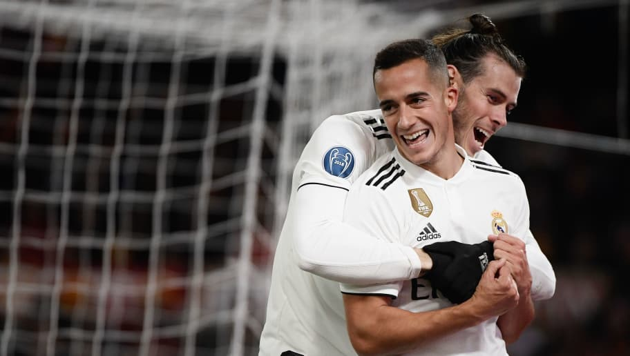 Real Madrid's Spanish midfielder Lucas Vazquez (Front) celebrates with Real Madrid's Welsh forward Gareth Bale after scoring during the UEFA Champions League group G football match AS Rome vs Real Madrid on November 27, 2018 at the Olympic stadium in Rome. (Photo by Filippo MONTEFORTE / AFP)        (Photo credit should read FILIPPO MONTEFORTE/AFP/Getty Images)