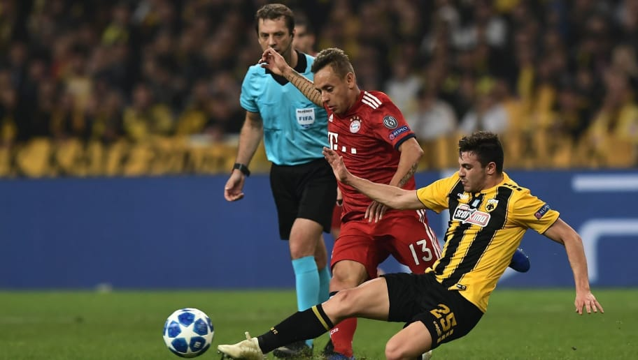 Bayern Munich's Brazilian defender Rafinha (L) vies with AEK's Greek midfielder Kostas Galanopoulos during the UEFA Champions League football match between AEK Athens FC and FC Bayern Munchen at the OACA Spyros Louis stadium in Athens on October 23, 2018. (Photo by ARIS MESSINIS / AFP)        (Photo credit should read ARIS MESSINIS/AFP/Getty Images)