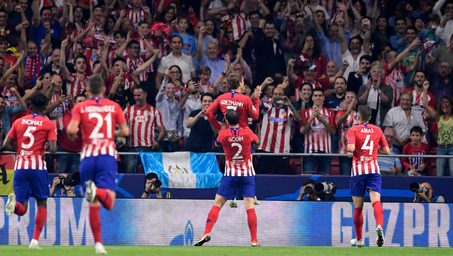 Atletico Madrid's French forward Antoine Griezmann (C) celebrates with teammates and supporters after scoring during the UEFA Champions League group A football match between Club Atletico de Madrid and Club Brugge at the Wanda Metropolitano stadium in Madrid on October 3, 2018. (Photo by JAVIER SORIANO / AFP)        (Photo credit should read JAVIER SORIANO/AFP/Getty Images)