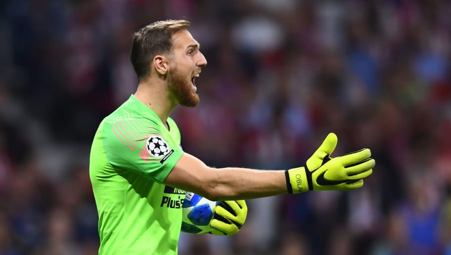 Atletico Madrid's Slovenian goalkeeper Jan Oblak gestures during the UEFA Champions League group A football match between Club Atletico de Madrid and Club Brugge at the Wanda Metropolitano stadium in Madrid on October 3, 2018. (Photo by GABRIEL BOUYS / AFP)        (Photo credit should read GABRIEL BOUYS/AFP/Getty Images)