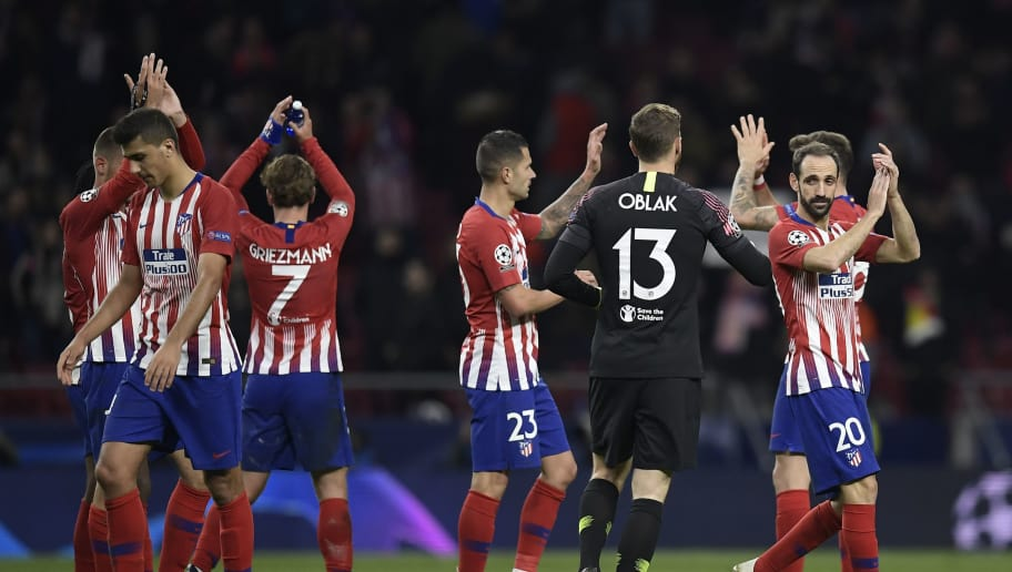Atletico players celebrate at the end of the UEFA Champions League group A football match between Club Atletico de Madrid and Borussia Dortmund at the Wanda Metropolitan stadium in Madrid on November 6, 2018. (Photo by OSCAR DEL POZO / AFP)        (Photo credit should read OSCAR DEL POZO/AFP/Getty Images)