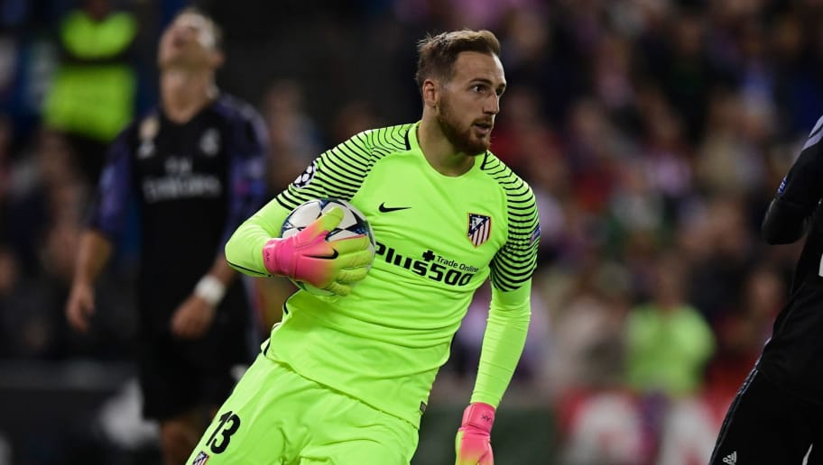 Atletico Madrid's Slovenian goalkeeper Jan Oblak (L) runs with the ball in his hands during the UEFA Champions League semi final second leg football match Club Atletico de Madrid vs Real Madrid CF at the Vicente Calderon stadium in Madrid, on May 10, 2017. / AFP PHOTO / JAVIER SORIANO        (Photo credit should read JAVIER SORIANO/AFP/Getty Images)