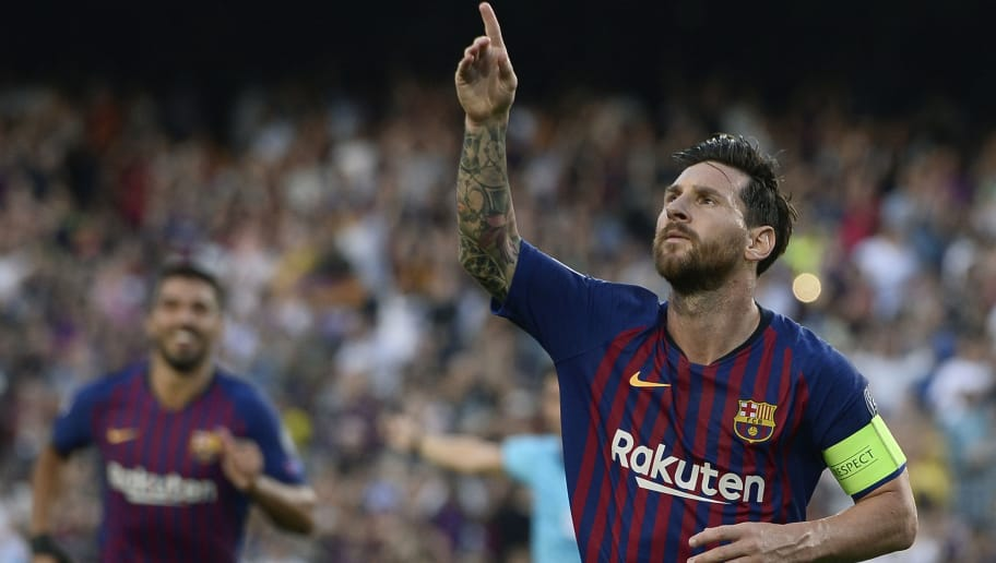 Barcelona's Argentinian forward Lionel Messi celebrates after scoring during the UEFA Champions' League group B football match FC Barcelona against PSV Eindhoven at the Camp Nou stadium in Barcelona on September 18, 2018. (Photo by Josep LAGO / AFP)        (Photo credit should read JOSEP LAGO/AFP/Getty Images)