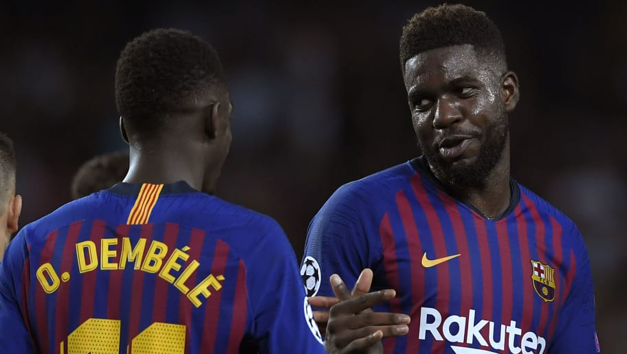 Barcelona's French forward Ousmane Dembele (C) celebrates after scoring with Barcelona's French defender Samuel Umtiti during the UEFA Champions' League group B football match FC Barcelona against PSV Eindhoven at the Camp Nou stadium in Barcelona on September 18, 2018. (Photo by LLUIS GENE / AFP)        (Photo credit should read LLUIS GENE/AFP/Getty Images)