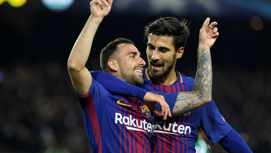Barcelona's Spanish forward Paco Alcacer (L) celebrates with Barcelona's Portuguese midfielder Andre Gomes after scoring a goal during the UEFA Champions League football match FC Barcelona vs Sporting CP at the Camp Nou stadium in Barcelona on December 5, 2017. / AFP PHOTO / LLUIS GENE        (Photo credit should read LLUIS GENE/AFP/Getty Images)